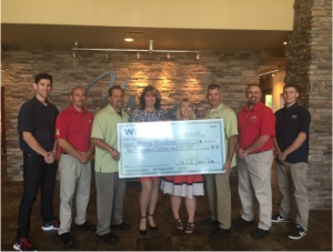 WIN Home Inspection Sierra representatives presenting a $10,000 check at the Mercy Sacramento home