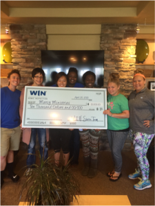 Mercy Sacramento residents happily posing with the generous donation from WIN Home Inspection Sierra