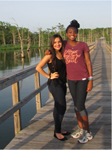 Mercy residents Alexa and December pose beside the beautiful Black Bayou.