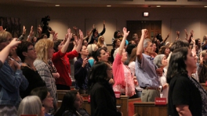Freedom Experience participants engaging in powerful worship.