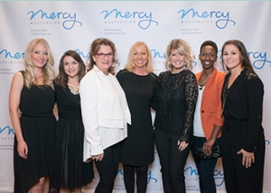 Nancy Alcorn and Natalie Grant with Jeanne Waters-Hill (in white) and the Touché Design Group