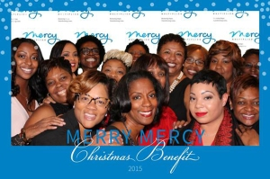 "SOGBC women ""all smiles"" at the Merry Mercy photo booth"